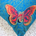 Turquoise Butterfly Cushion detail